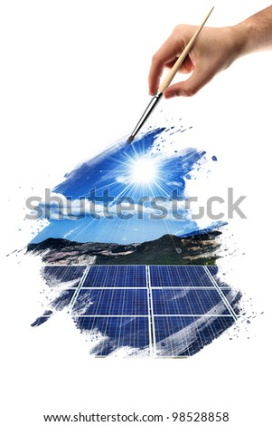 hand that paints a picture with a solar panel - stock photo