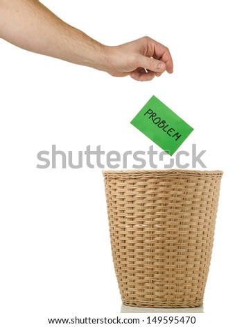 Hand throwing a piece of paper - stock photo