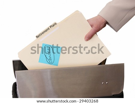 hand throwing retirement plans in trash - stock photo