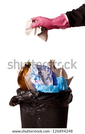 hand throwing rubbish in a trash bin - stock photo