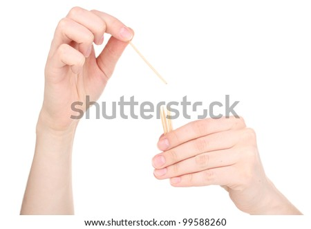 Hand throwing toothpick isolated on white