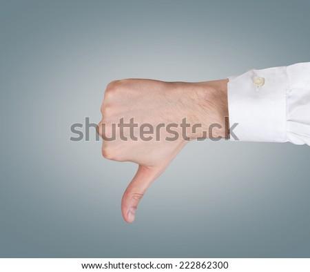 Hand thumb down - stock photo
