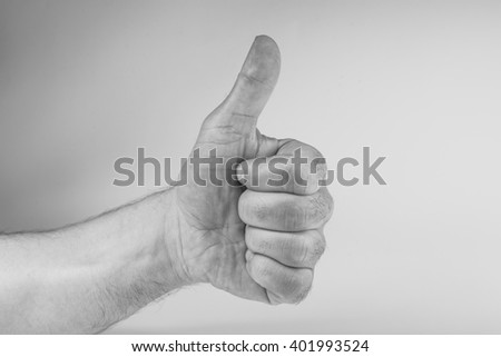 Hand thumb up and like isolated on white background, black and white photography - stock photo