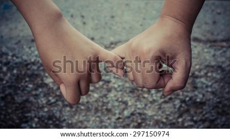 hand to pinky - stock photo