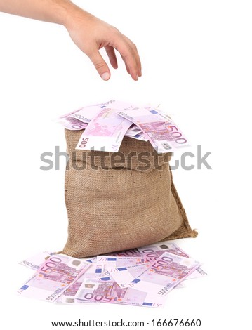 Hand to sack with euro bills. Isolated on a white background. - stock photo