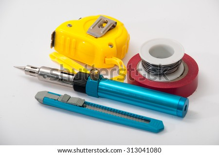 Hand tool for repairing electrical wiring. - stock photo