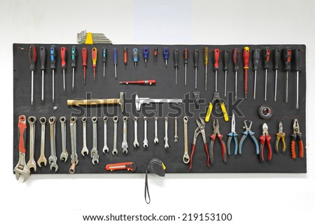 Hand tools nicely organized at wall board - stock photo