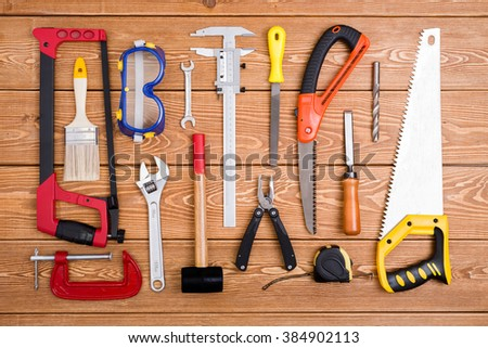 Hand tools on wood background