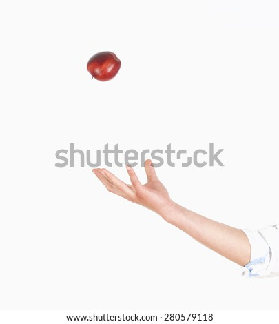 Hand Tossing Red Apple in the Air  - stock photo