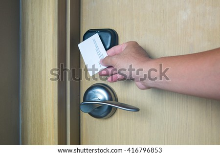 hand touch key card on hotel door