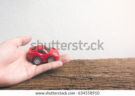 hand touch red car in car for cash concept