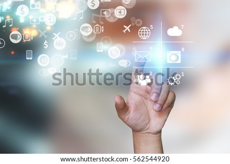 Hand touch screen icons on virtual screen. Social media concept.
