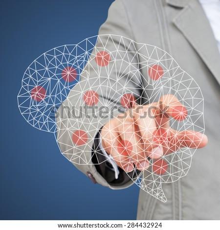 Hand touching brain symbol - stock photo