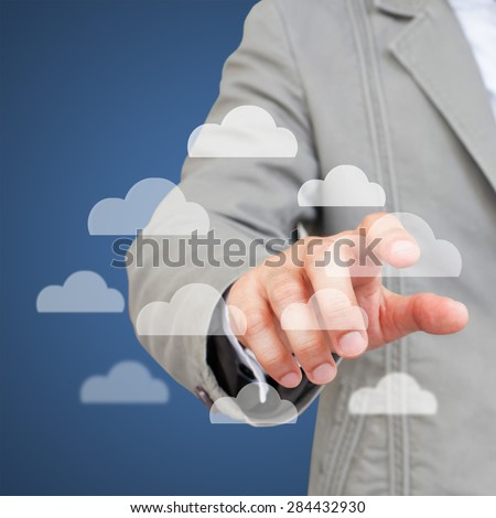 Hand touching cloud computing interface - stock photo