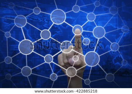 Hand touching connection network on world map and city tower, Elements of this image furnished by NASA