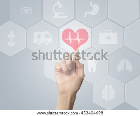 Hand touching E-Health symbol connected to health - stock photo