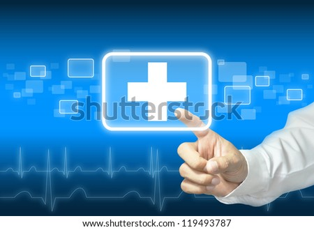 Hand touching first aid sign - abstract medical background