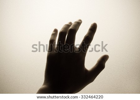 hand touching frosted glass - stock photo