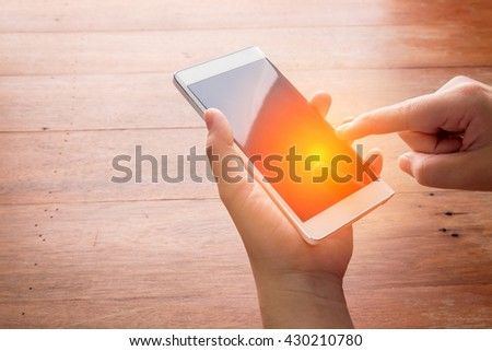 hand touching on mobile smartphone - focus on top of the phone - stock photo