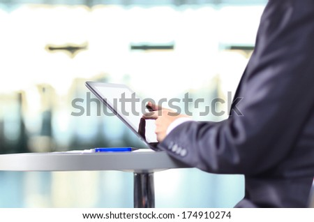 Hand touching on modern digital tablet pc at the workplace.  - stock photo