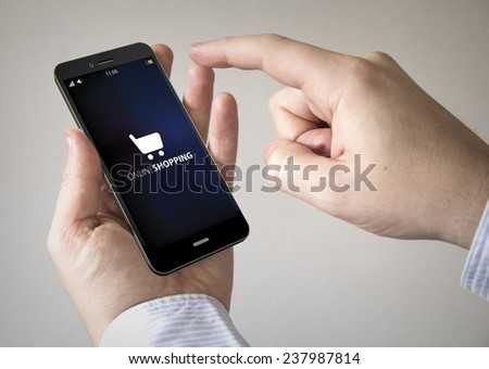 hand touching screen on modern mobile smart phone with online shopping on the screen - stock photo