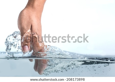 hand touching surface of water, isolated on white background - stock photo