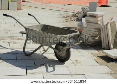 Hand Truck for transporting construction material - stock photo