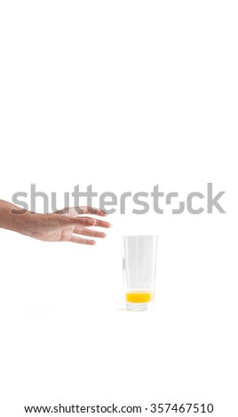 Hand try to hold an empty juice glass on isolated white background