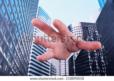 Hand trying to get out of corporation concept - stock photo