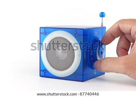 Hand tuning or turning Blue radio cube box - stock photo