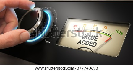 Hand turning a knob up to the maximum with a dial where it is written the text value added. Concept image for illustration of competitive advantage.