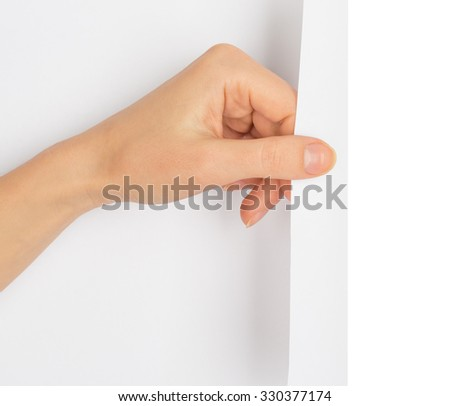 Hand turning blank page on isolated white background - stock photo