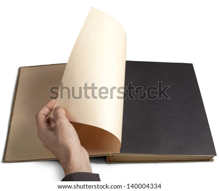 Hand turning next page of old book. Space for your copy ar design.  - stock photo