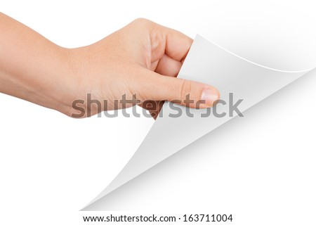 Hand turning page, isolated on white background. - stock photo
