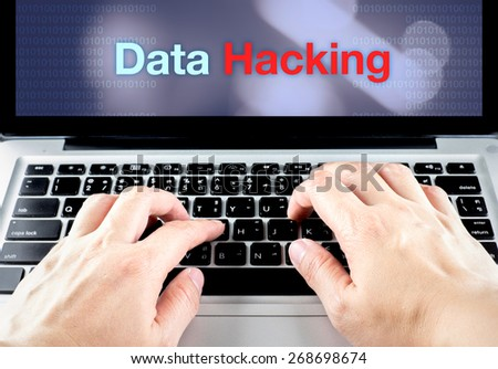 hand type on laptop with data hacking on screen with blur background, internet security concept. - stock photo