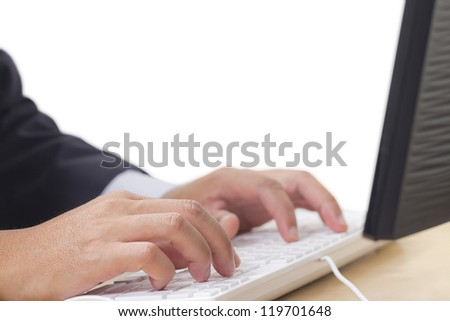 Hand typing computer keyboard - stock photo