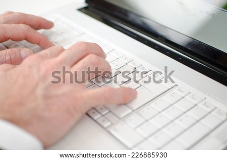 Hand typing on a keyboard, closeup