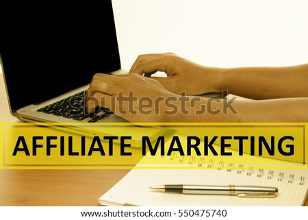 Hand Typing on keyboard with text AFFILIATE MARKETING