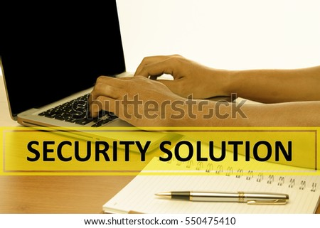 Hand Typing on keyboard with text SECURITY SOLUTION