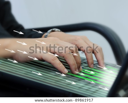 Hand typing on laptop computer keyboard - stock photo