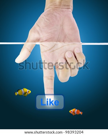Hand under water. Press the touch screen LIKE button. - stock photo