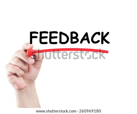 Hand underlining feedback word with marker on transparent glass and white background with copy space - stock photo