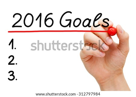 Hand underlining 2016 Goals with red marker on transparent wipe board. Blank list of goals for year 2016 isolated on white.