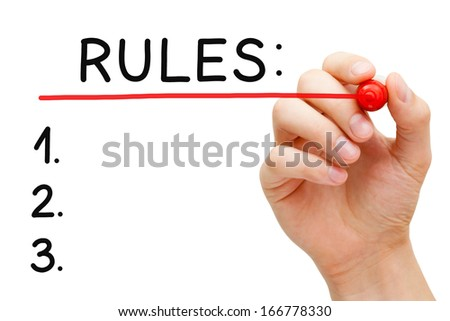 Hand underlining Rules with red marker on transparent wipe board. - stock photo