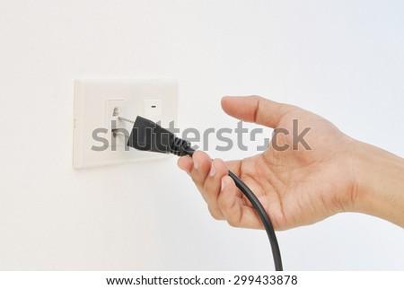 Hand unplug , electric shock - stock photo