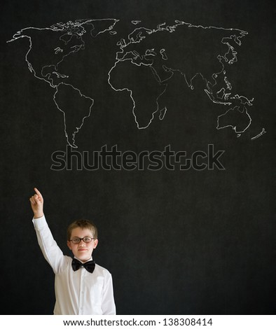 Hand up answer boy dressed up as business man with chalk geography world map on blackboard background - stock photo