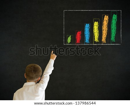 Hand up answer boy dressed up as business man with chalk graph or chart on blackboard background