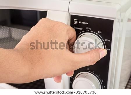 Hand use microwave - stock photo