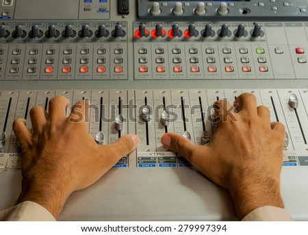 Hand Used to control the audio broadcast of sound engineers. - stock photo