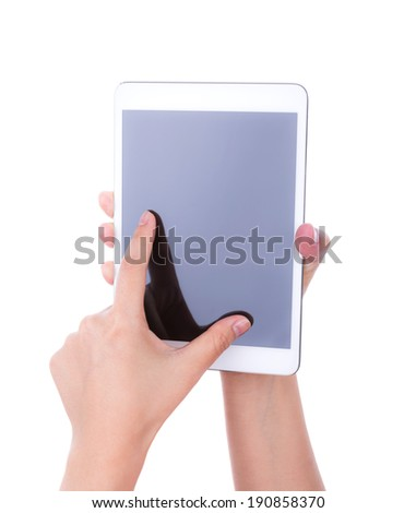 Hand  using a touch screen device against white background - stock photo